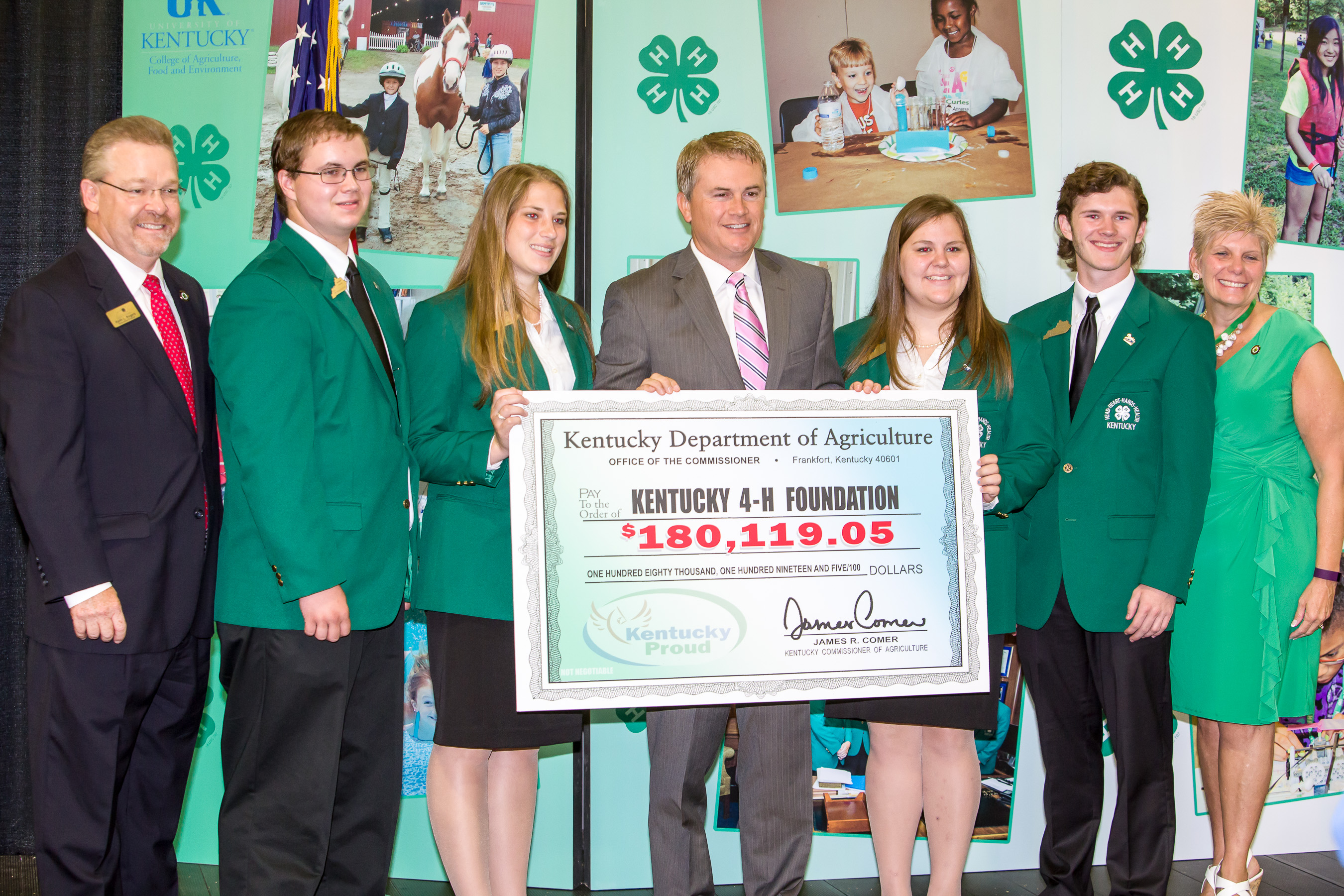 James Comer, Kentucky Commissioner of Agriculture, presents Kentucky 4-H a check from proceeds of the Kentucky farm license plate voluntary donations to the Agricultural Program Trust Fund. The Kentucky 4-H Foundation held it's annual Friends of Kentucky 4-H breakfast in Cloverville, the Kentucky 4-H showcase, In the West Hall of the Kentucky Exposition Center at the 2015 Kentucky State Fair on Friday, August 21, 2015.