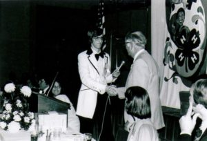State 4-H Week 1977, Paul Hall, President, is recognizing our head clover, Conrad Feltner.