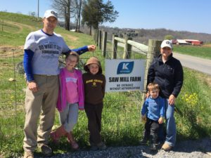 The Miller's at their farming operation, Sawmill Farm.  From left to right Aaron, Mattie, Avery, Aiden and Melissa.