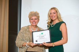 Kentucky 4-H Foundation Board of Directors Chairperson Pam Rowsey Larson presented Haley Anderson with the Michael Bandy/Ale-8-One Scholarship at the 2016 Kentucky 4-H Achievement Ceremony in Memorial Hall.