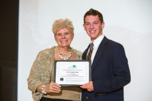 Kentucky 4-H Foundation Board of Directors Chairperson Pam Rowsey Larson presented Noah Lane Carter with the James W. Kidwell Memorial Scholarship at the 2016 Kentucky 4-H Achievement Ceremony in Memorial Hall.