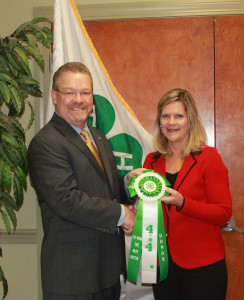 Cindy G. Moore, first club member of 4IN4, being presented her Rosette from Keith L. Rogers, Executive Director, Kentucky 4-H Foundation.
